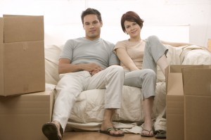 Moving Couple Sitting on a Couch